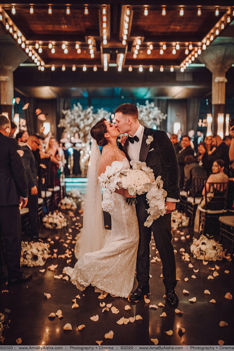 first kiss ceremony photo at the astorian by houston wedding photographer