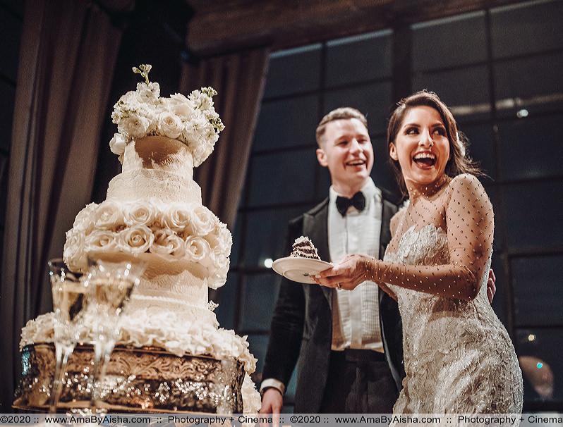 couple cuts wedding cake captured by houston wedding photographer